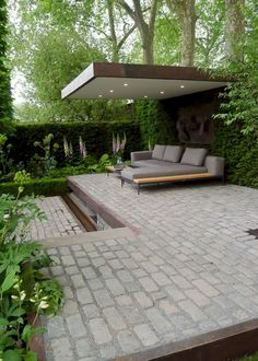 chelsea flower show 2016 Support the husqvarna garden. This modern landscaped backyard has a raised outdoor lounge deck, a wood burning firepit, succulents, bamboo and a vegetable garden. Contemporary Garden Design, Modern Landscape Design, Modern Landscaping, Backyard Landscaping, Landscaping Ideas, Backyard Patio, Modern Backyard, Garden Modern, Backyard Ideas