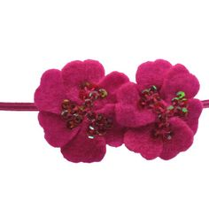 Sequin Felt Flowers on elastic skinny band. These bands add just the right amount of sparkle and dress up any outfit perfectly.  While these are perfect for newborn, babies, and all age girls, these are very popular for adults. Moo G Clips has a lot of loyal adult customers wearing the Sequin Felt Flowers Skinny Band. Hot Pink