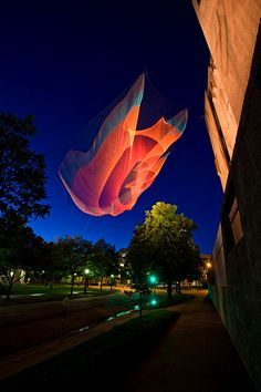 "Photo: Janet Echelman  Janet Echelman 's 230-foot-long aerial sculpture "" 1.26 ""  suspends from the roof of the 7-story Denver Art Museum a..."