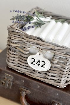 I think I'm inspired to store my Shabbat candles in a basket, instead of just keeping them in in the utility closet in their flimsy box...the sprig of lavender is a must, of course!  from Vintage chic