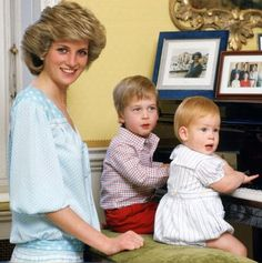 UNITED KINGDOM - OCTOBER 04 1985 Diana, Princess of Wales with her sons, Prince William and Prince Harry, at the piano in Kensington Palace.