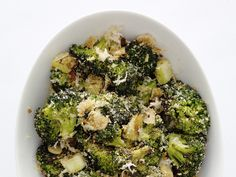 Parmesan Broccoli....it's in the oven now and smells amazing!  Pairing with oven grilled T-Bone Steaks.