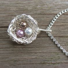 birds nest pendants are easy and really pretty.  They can be done with a variety of wife gauges, beads, and other little neat additions.
