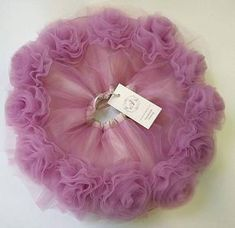 Beautiful ruffly baby tutu and flower baby skirt are the ideal first present baby! This light lilac tutu is made of a double layer of tulle and a layer of taffeta. With an elasticated waist for a comfortable secure fit, this skirt is perfect for any baby on the move. The set comes with a