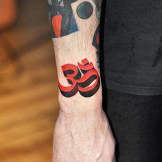 Om tattoo on the right wrist. Tattoo artist: David Côté