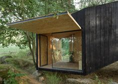 Forest Retreat Rests on a Boulder in a Czech Wood