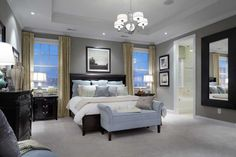 Grey, dark brown and blue room. Wow. Beautifully decorated.