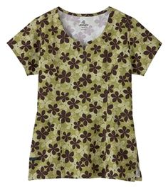 "Jockey Scrubs Two-Pocket Tri-Blend Print Top in ""Heather Olive"" 2217-510 Jockey Scrubs Two-Pocket Tri-Blend Print    Soft and feminine.    Its styling complements your shape and has all the  benefits you'll need: a jewel neckline, front and back  princess seaming, two side entry pockets and hem  vents for ease of movement.  Tri-blend: 72% polyester, 21% rayon, 7% spandex  Length: 26"" Sizes: XS -3X  style # 2217 $23.99 #scrubs #scrubcouture #nurses"