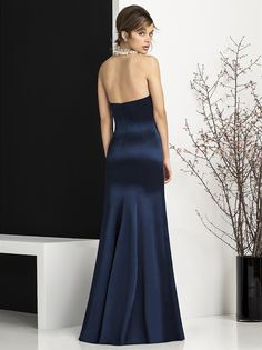 Set in a rich stretch of gleaming matte satin and structured with a gentle mermaid silhouette, the After Six Bridesmaids style 6673 dress vows to add romance and grace to your grandiose celebration. Free of any glittering embellishment, this striking piece of creation captures more attention with its luscious strapless sweetheart neckline. Princess seaming draws a more flattering figure, pivoting around the drop waist as the silhouette flares and cascades into a full skirt that lightly…