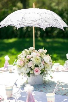 Umbrella baby shower flower arrangement centerpiece