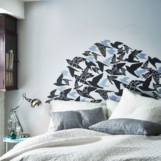 Use SLÄTTHULT stickers to create a personalized headboard in your bedroom. How about these decals to bring together the blue and black, and create a headboard?