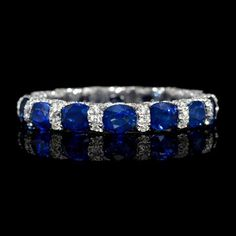 This magnificent white gold eternity wedding band ring, features 182 round brilliant cut white diamonds, weighing carat total and 14 oval cut blue sapphires, weighing carats total. Blue Sapphire Rings, Blue Rings, White Gold Rings, White Gold Diamonds, Sapphire Band, Sapphire Wedding, Wedding Rings Solitaire, Wedding Ring Bands, Eternity Ring Diamond