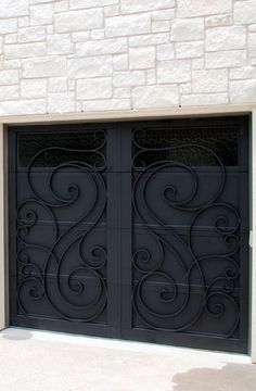 Doors provides hand-forged, custom-made iron staircase & balcony railings for your home in Texas & Florida. Call us at Doors provides hand-forged, custom-made iron staircase & balcony railings for your home in Texas & Florida. Metal Garage Doors, Custom Garage Doors, Garage Gate, Garage Door Design, Shed Doors, Custom Garages, Front Door Design, Iron Staircase, Balcony Railing