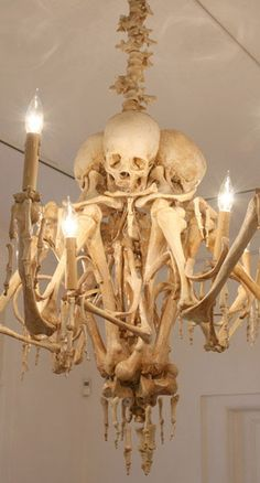 Skeleton Chandelier - Could just attach some dollar tree bones to your chandelier with wire. :) - Sarah