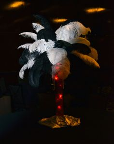 Feather Centerpiece - Great Gatsby www.idealpartydecorators.com