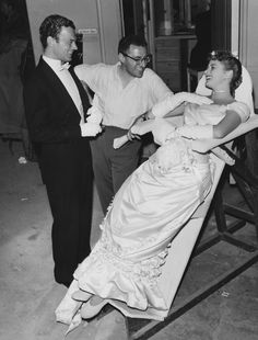 Joseph Cotten, George Cukor and Ingrid Bergman on the set of Gaslight (1944)  This chair she has is hilarious!  Is it so she wouldn't wrinkle her gown?
