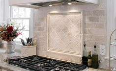 black counter top white brick traverteen splash | Antiqued Ivory Tile Backsplash White Cabinets