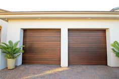 Traditional roll up garage doors can be made out of wood versus traditional steel. Traditional roll up garage doors can be made out of wood versus traditional steel. Brown Garage Door, Roll Up Garage Door, Faux Wood Garage Door, Single Garage Door, Metal Garage Doors, Garage Door Windows, Modern Garage Doors, Garage Door Styles, Roll Up Doors