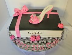Shoe box themed birthday cake with fondant shoe topper. Design was brought in by client by unknown cake artist. Client just changed the shoe design.