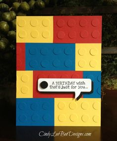 Legos Card Recipe: STAMPS: SU Remembering Your Birthday INK: Memento Tuxedo Black PAPER: SU Basic Black, SU Real Red, SU Daffodil Delight, SU Pacific Point TOOLS: SU Itty Bitty Punch Pack Circle, SU Word Bubbles Framelits   Legos are 1 3/8″ by 2 1/2″- cut and staggered