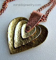 The Gallery on this site is filled with beautiful Metal Work, and Wire Work jewelry creations. A Must See.