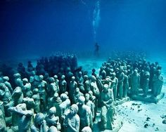"""""""The Silent Evolution"""" exhibit is a collection of 400 underwater sculptures, mostly depicting people seemingly frozen in time on the ocean floor to provide a stable habitat for marine life, these underwater structures also make great places to scuba dive."""