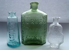 How to Clean Old Glass bottles with rice, vinegar and dish soap. It Works!