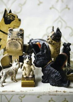 a collection of dog statuary