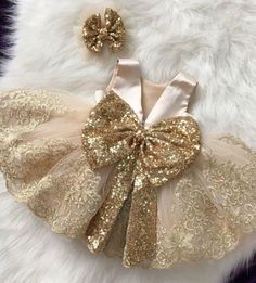 This dress comes with a gold sequin bow placed on the back. The trim on this dress is a gold lace. - Baby Girl Dress - Ideas of Baby Girl Dress Baby Girl Frocks, Baby Girl Party Dresses, Kids Frocks, Frocks For Girls, Little Girl Dresses, Flower Girl Dresses, Baby Outfits, Cute Baby Dresses, Vegas Outfits