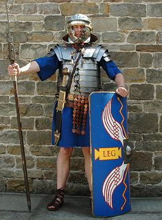 A legionary wearing the famous banded armour, the lorica segmentata, and the typical imperial 'Gallic' helmet. Also he has with him the famous curved, square shield, the gladius (sword) and a throwing spear (pilum).