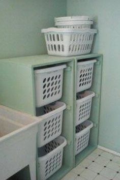A way to keep laundry organized and off the ground.  I HAVE USED THIS METHOD IN A FLOOR TO CEILING CABINET, OPEN FACED, WITH ADJUSTABLE SHELVES TO HOLD LAUNDRY BASKETS, DOG TOWELS, MISC. SUPPLIES.