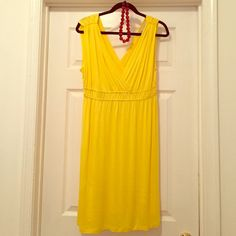 LOFT NWOT Yellow V-Neck and V-Back Sundress NWOT never worn! Sunny Yellow LOFT sundress. Features cinched waist, v-neck, v-back. Perfect dress for summer or as a beach/pool coverup. 97% Rayon/3% Spandex. Machine wash. LOFT Dresses