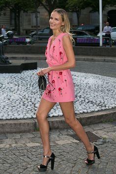 Natasha Poly is all lean, willowy legs in a Miu Miu minidress.