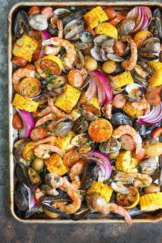 Sheet Pan Clam Bake - This ONE POT clam bake is so easy, it's practically EFFORTLESS! With potatoes, corn, mussels, clams, shrimp, chorizo and so much more!