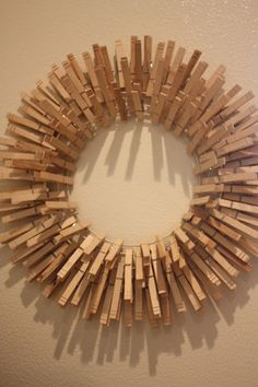 Clothespin wreath. I would love to hang this in the laundry room!