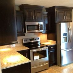 microwave above stove with raised cabinet above | Kitchens ...