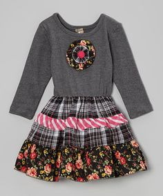 Pretty, contrasting colors and frilly embellishments make this sweet little number the stuff of a little girl's dreams. Soft cotton comfort makes it as easy to wear as it is on the eye. It's just right for fancy occasions and playdates alike.