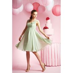 Short cocktail dress with pleated bodice and empire waist design. Bonquet adorns the left shoulder strap. Made of chiffon. Free made-to-measurement service for any size. Available colors seen as in Color Options.