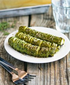 Hasselback Zucchini with Garlic Thyme Butter and Parmesan - doesn't look like he subtracts fiber from the nutrtionals, but there are roughly 3g of Fiber in this recipe so it lowers the net carb count per serving. / #lowcarb shared on https://facebook.com/lowcarbzen
