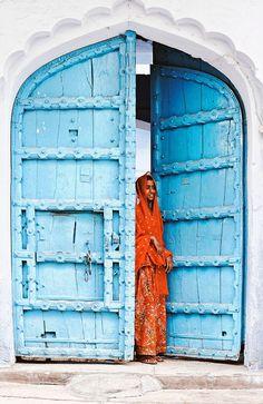 Figure at sky blue door . Poku in Pushkar , India ,by Philippe CAP on Printed Napkins, Napkins Set, Indiana, Indian Desert, Indian Doors, Cultural Architecture, Gothic Architecture, Ancient Architecture, Rural India