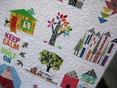 Love the trees on this quilt. Love the tall skinny buildings.