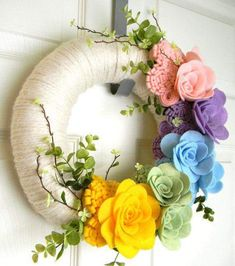 : 12 inch Felt and Yarn Wreath - This Is Fantastic: DIY Yarn Wreath with Felt Flowers by anquan Felt Flower Wreaths, Felt Wreath, Wreath Crafts, Easter Wreaths, Diy Wreath, Felt Flowers, Diy Flowers, Fabric Flowers, Paper Flowers