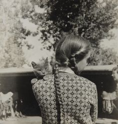 Elizabeth Bishop. Photograph by Louise Crane of Bishop and her cat, Minnow. Via the Cat Museum of San Francisco.