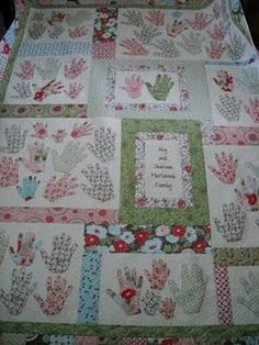 Family hands quilt. What an awesome idea!  I also love the way this quilt is structured. The hands appear to be grouped by family.