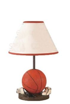 """Set of 2 Table Lamps with Basketball Base by Coaster Home Furnishings. $56.45. Dimension: 10"""" Diameter x 15 1/4""""H Finish: Orange, White Material: Wood Set of 2 Table Lamps with Basketball Base Features basketball and sport shoes base with white shade. Item is perfect for kid's bedroom. Also available in football, baseball glove and soccer base. Bulbs are not included. Simple assembly required."""