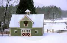 Green barn in winter