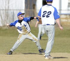 Hoosick Falls second baseman Tyler Rondeau (11) throws to first from shortstop side of second base unable to get Hoosic Valley's John Rooney (not in photo) during the third inning of Tuesday's Wasaren League game in Hoosick Falls. Hoosick Falls shortstop Josh Buogue (22) looks on. (J.S. Carras/The Record)