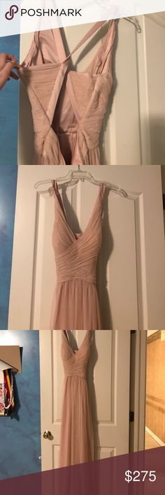 Bhldn blush mesh tulle floor length dress This gorgeous anthropologie/ bhldn blush dress is perfect for any prom/ bridesmaid/ formal occasion, it is lightweight and flowy, has a cute cross cross back with zipper and v neck with roushing. Never worn. Brand new, discontinued style. Anthropologie Dresses Prom