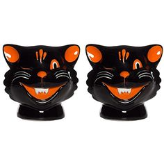 Sourpuss Cats Salt & Pepper Shakers Black Sourpuss https://www.amazon.com/dp/B01BN7VBNI/ref=cm_sw_r_pi_dp_x_qpFvyb76BZEK2