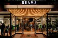 Japan Stockist - Beams, Universal Works is stocked in the Fenica department alongside Scandinavian furniture. Hotel Lobby Design, Design Entrée, Facade Design, Entrance Design, Entrance Gates, Entrance Lighting, Facade Lighting, Interior Lighting, Retail Facade